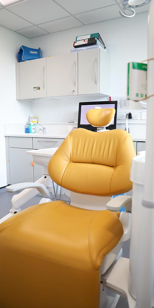 orange dental chair in clean treatment