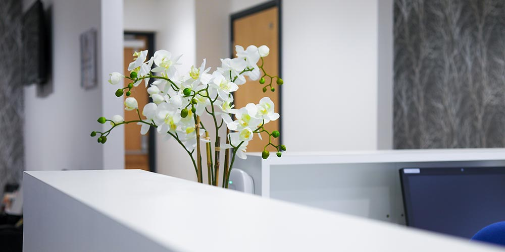 picture of white flowers on reception desk